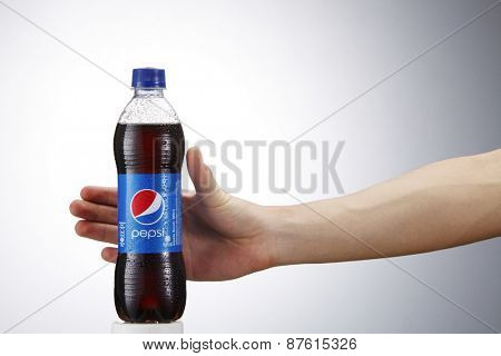 Kuala Lumpur,Malaysia 9th April 2015,Reaching a can of Pepsi . Pepsi is a carbonated soft drink produced and manufactured by PepsiCo Inc. an American multinational food and beverage company.