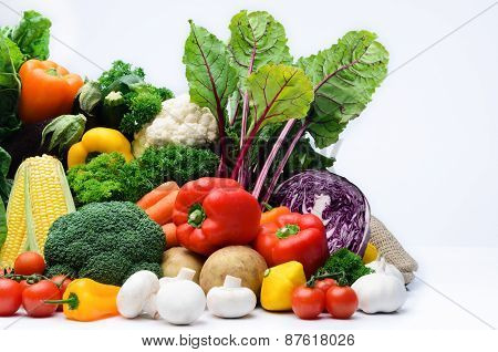 Fresh Raw Organic Vegetable Produce, Assortment Of Corn, Peppers, Broccoli, Mushrooms, Beets, Cabbag