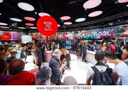 COLOGNE, GERMANY - SEPTEMBER 19, 2014: Canon stand in the Photokina Exhibition. The Photokina is the world's largest trade fair for the photographic and imaging industries