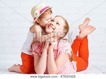 Happy  Baby Daughter Kissing Mother