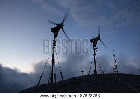 Wind farm at the foot of Mount Triglav (2,864 m) in the Julian Alps, Slovenia.