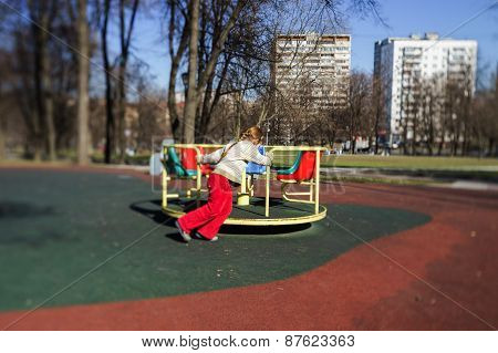 Cute Little Girl Playing On Child Playground