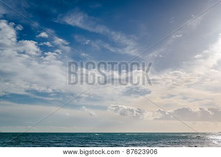 Bright Cloudy Sky And Horizon Over The Sea