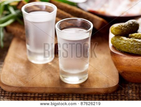 Glasses Of Vodka With Various Snack