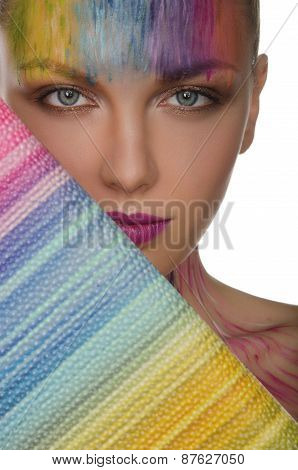 Young Woman With Colorful Purse And Face Art