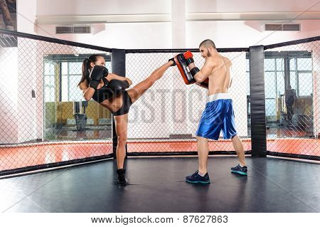 Girl kickboxer and her coach