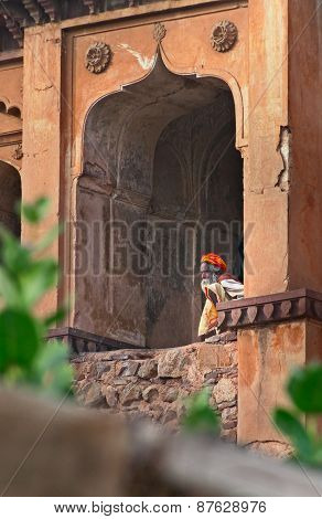 Sadhu Sitting At Window Of Chaturbhuj Temple