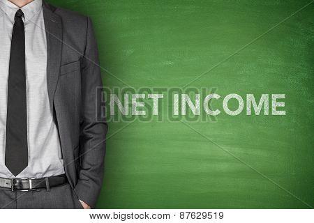 Net income text on green blackboard