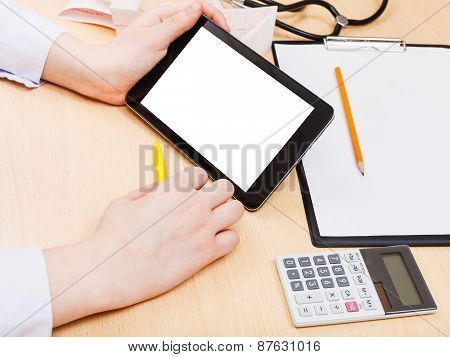 Doctor Read From Tablet Pc With Cut Out Screen