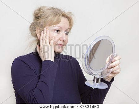 Senior Looking In Mirror