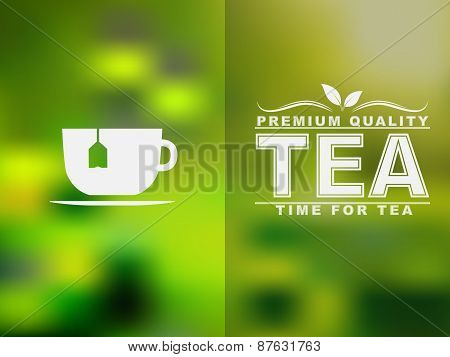 Tea Cup Icon And Text Design With A Blurred Background.