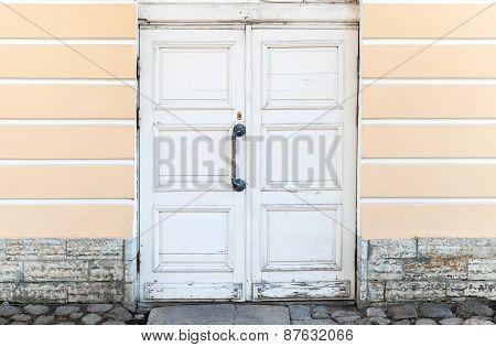 Old White Wooden Door In Classical Building Facade