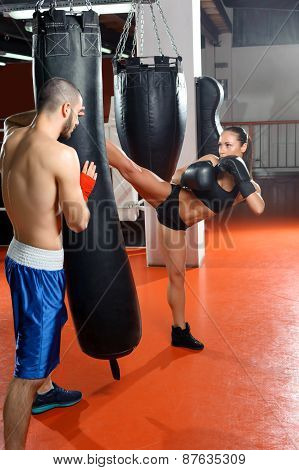 Boxing coach trains his team