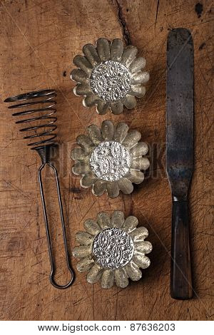 Vintage  Baking utensils - spatula, tins and moulds on wooden board