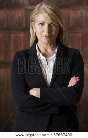 Portrait Of Mature Businesswoman In Boardroom