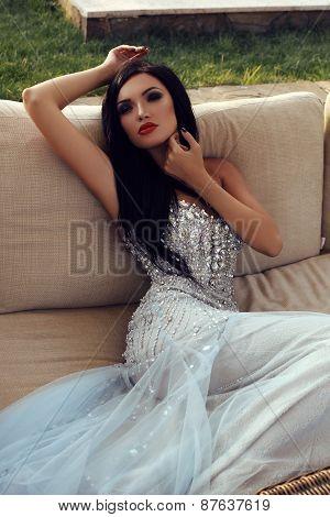 Beautiful Sensual Woman With Dark Hair In Luxurious Sequin Dress