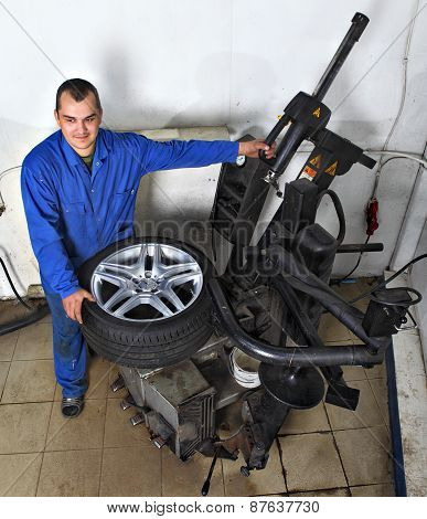 Tyre Changing Machine, Mechanic Fixing Tire In Car Service