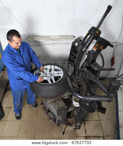 Workstation, Maintenance Vehicles, Worker Operates The Machine Automatic Tire Mounting.