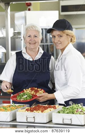 Portrait Of Two Dinner Ladies In School Cafeteria