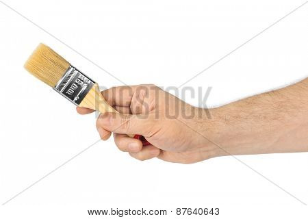 Hand with brush isolated on white background