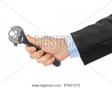 Adjustable spanner in hand isolated on white background