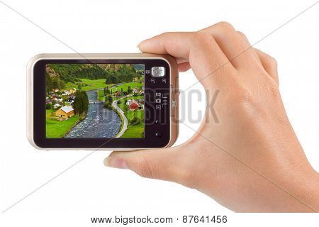 Hand with camera and Norway travel photo isolated on white background