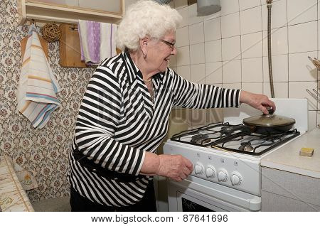 Senior Woman Prepares Food