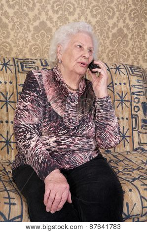 Senior Woman Speaks On The Phone