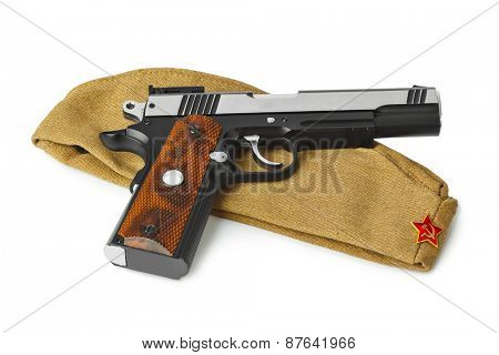 Soviet Army soldiers forage-cap and pistol isolated on white background