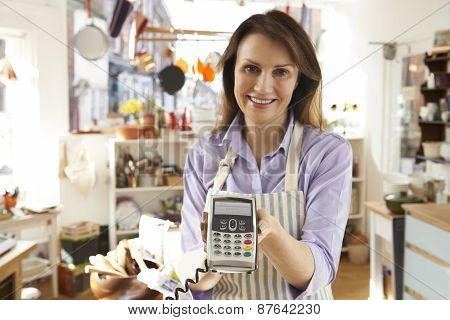 Sales Assistant In Homeware Store With Credit Card Machine