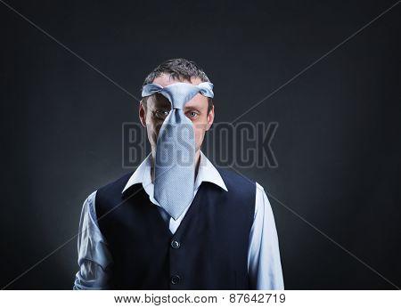 Strange man with necktie on his head