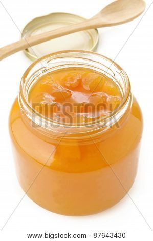 Jar Of Peach Jam On White Background