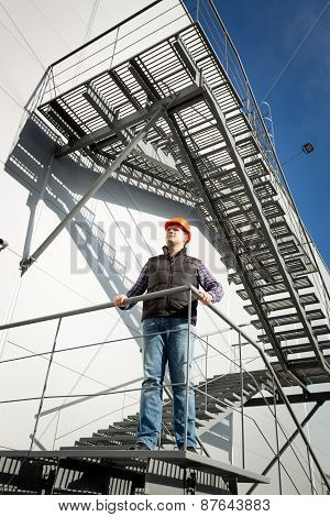 Building Control Inspector Standing On Metal Staircase