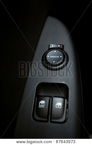 Closeup Shot Of Knobs Controlling Windows And Mirrors In Car