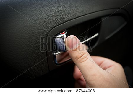 Male Driver Pressing Button Locking Doors In Car