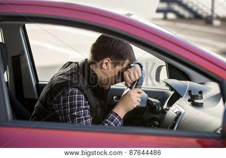 Portrait Of Upset Man Holding Steering Wheel