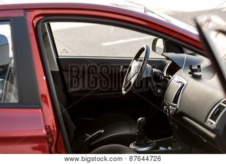 Red Car With Open Passenger Seat Door