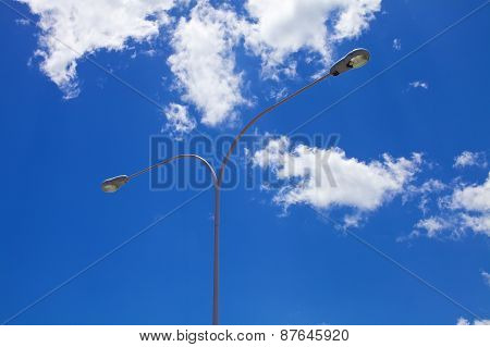 Street light against blue skies background