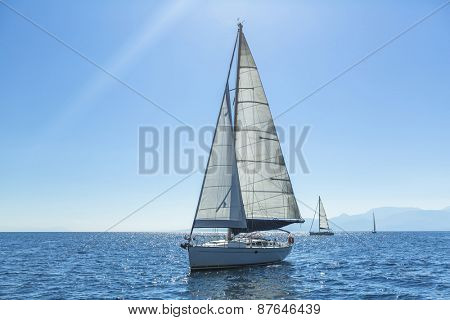 Ship yachts with white sails in the open Sea. Sailing. Luxury boats.