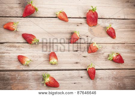 Top view of fresh strawberries on rustic table
