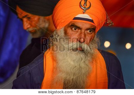 Devotee Sikh With Orange Turban