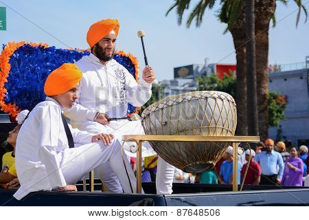Devotee Sikh Beating A Drum.