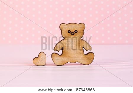 Wooden Icon Of Teddy Bear With Little Heart On Pink Background