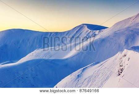 Mountain range glowing by sunlight. View from ski resort Dragobrat. Dramatic morning scene. Carpathian, Ukraine, Europe. Beauty world.