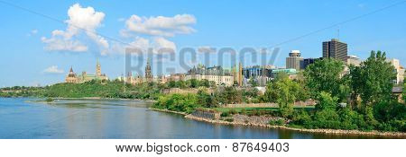 Ottawa cityscape panorama in the day over river with historical architecture.