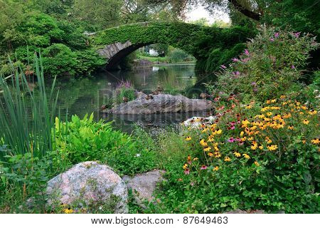 Central Park Spring with bridge in midtown Manhattan New York City