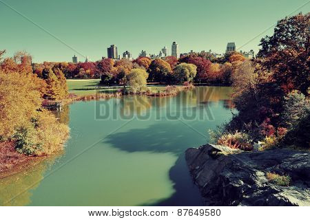 Central Park Autumn and midtown skyline over lake in Manhattan New York City