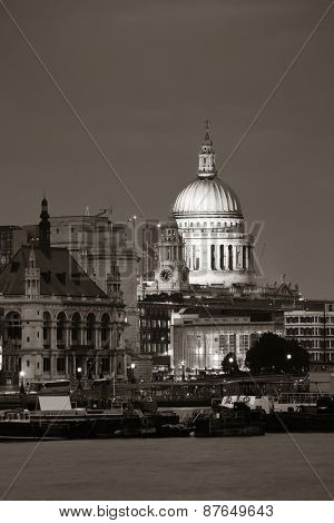 St Pauls Cathedral over Thames River at night in London in black and white.