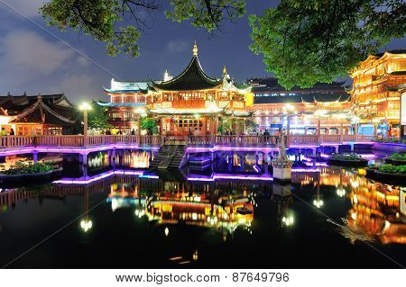 Historical pagoda stile building in Shanghai at night