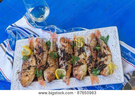 Fried fish on plate, closeup